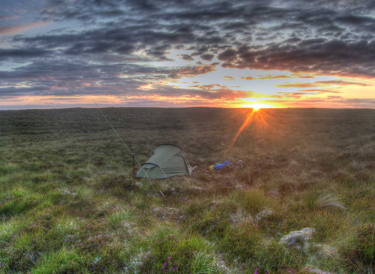 Sunset while camping on remote Lewis moorland